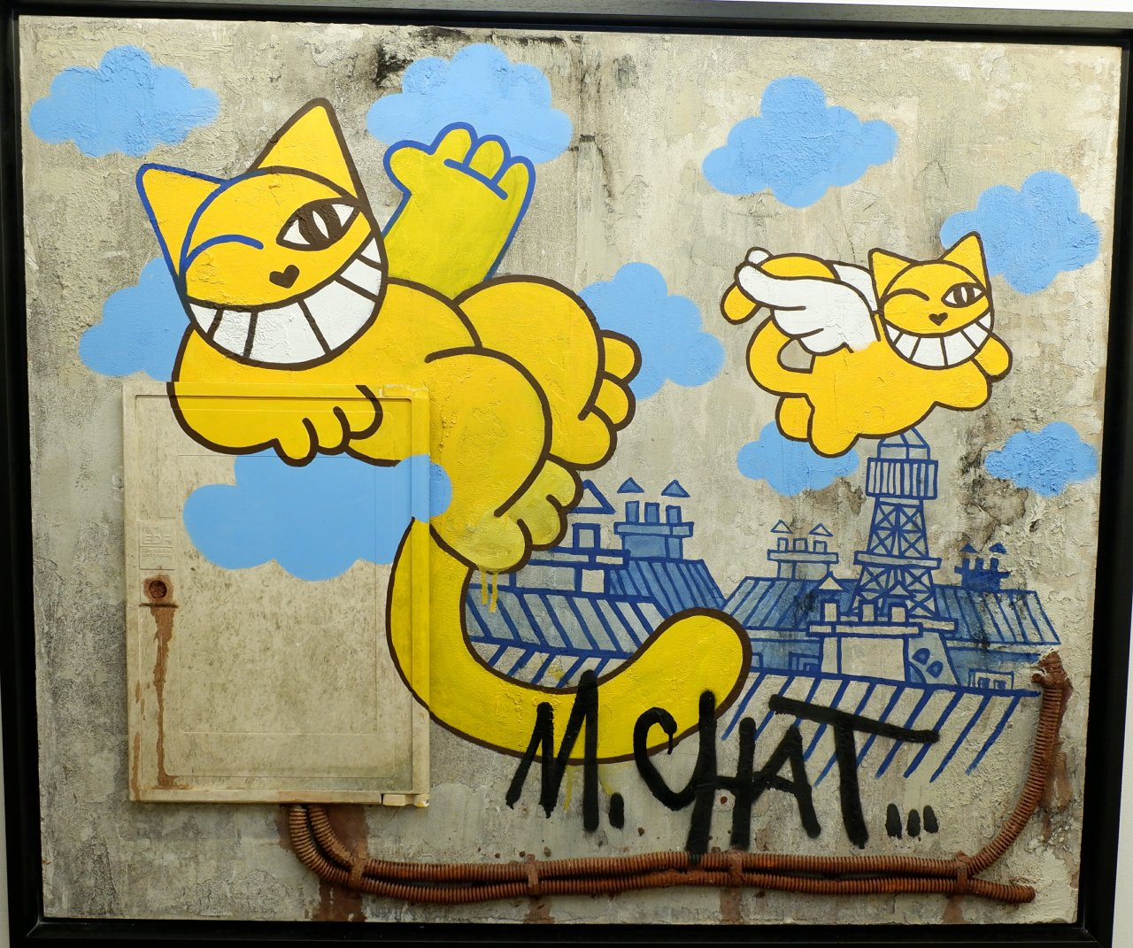 M Chat en mode  murs de Paris