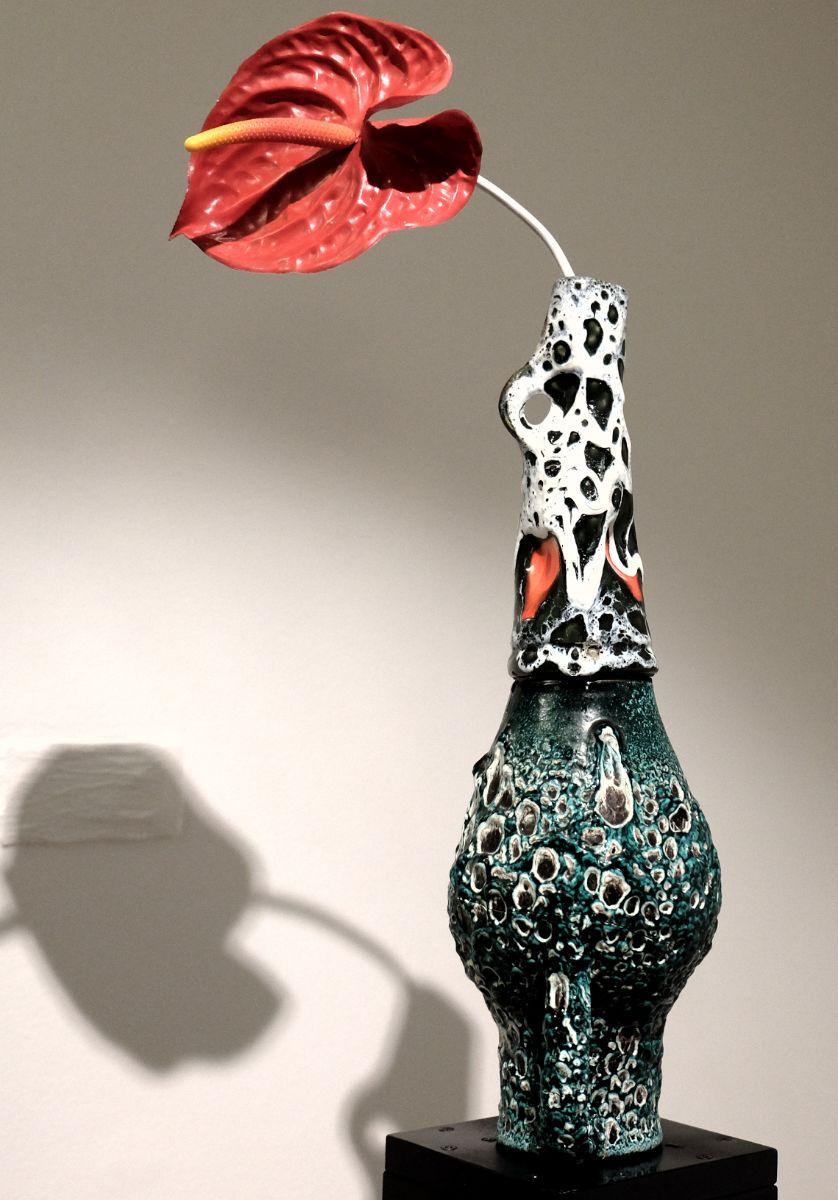 Le nom de l expo est Vase communiquant